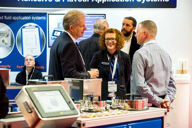 Exhibitors discuss the latest products during TABEXPO