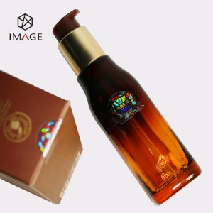 transparent-hologram-sticker-is-affixed-to-cosmetic-bottle-body-and-package-seal