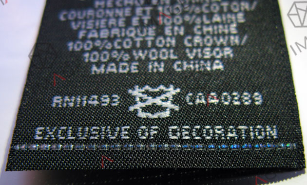 The woven label security thread